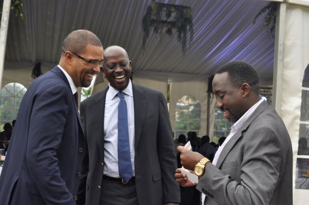 Daniel Petterson (L), the Hima Cement Country CEO, Hannington Karuhanga (C) the Chairman Hima Cement share a light moment with Michael Mugisa, the ED of NFA during the Geocycle launch