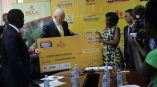 MTN's CEO Brian Gouldie handing over a dummy cheque of MTN Marathon proceeds worth Shs500m to Executive Director of KCCA Jenifer Musisi
