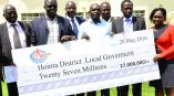Hoima district leaders receiving a dummy cheque of Shs27m representatives of CNOOC Uganda