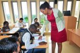 A lecturer conducts a lesson at Victoria University Kampala