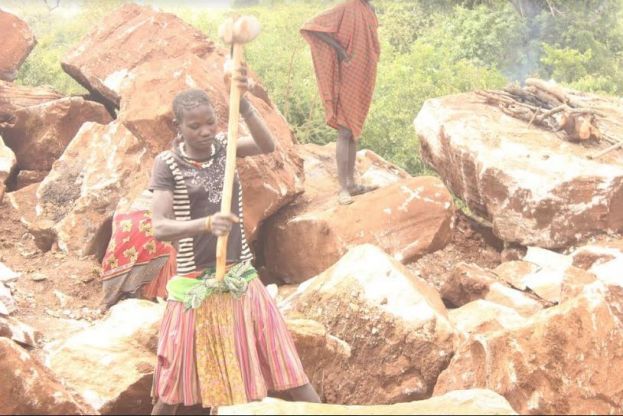 A young female working as a stone crusher in one of the mining sites in Karamoja sub region