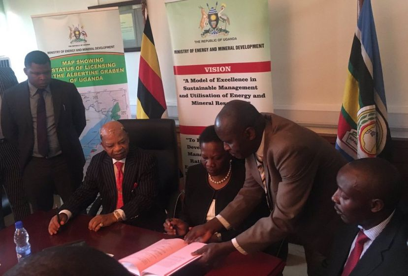 Minister Irene Muloni and Oranto's Prince Eze signing the PSAs