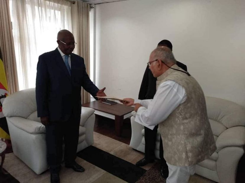 Sudhir presenting his credentials to Sam Kutesa, Uganda' foreign minister