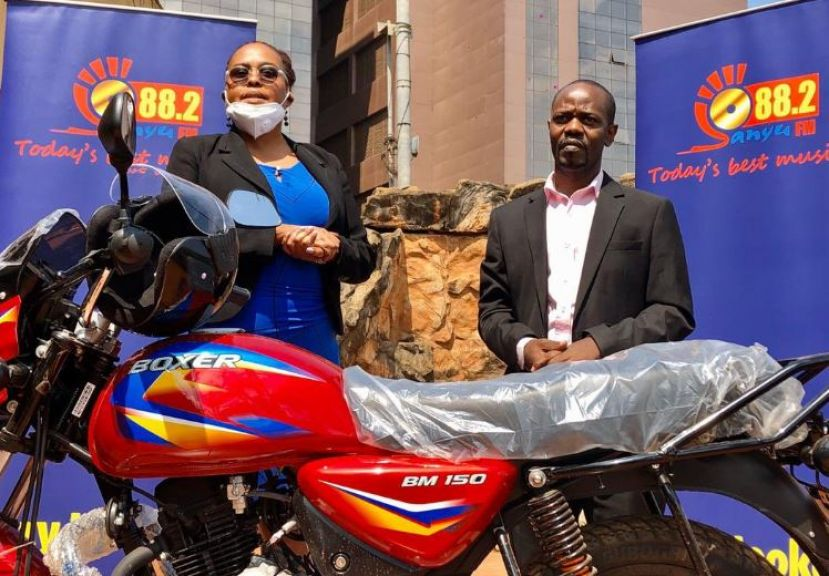 The station's Chief operations officer Betsy Mugamba handed over the motorcycle and its documentation to Kyaka