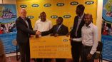 MTN CEO Brian Gouldie (Extreme Left) hands over dummy cheque to Rotary Uganda Team