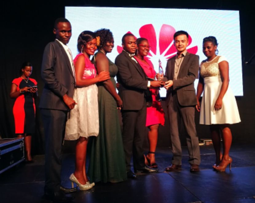 M-VOUCHER Team receiving an ICT for Development Award from the former Managing Director of Huawei Uganda Mr. Stanley Chyn at the UCC ACIA Awards 2017. (Evelyn Namara is Second left)