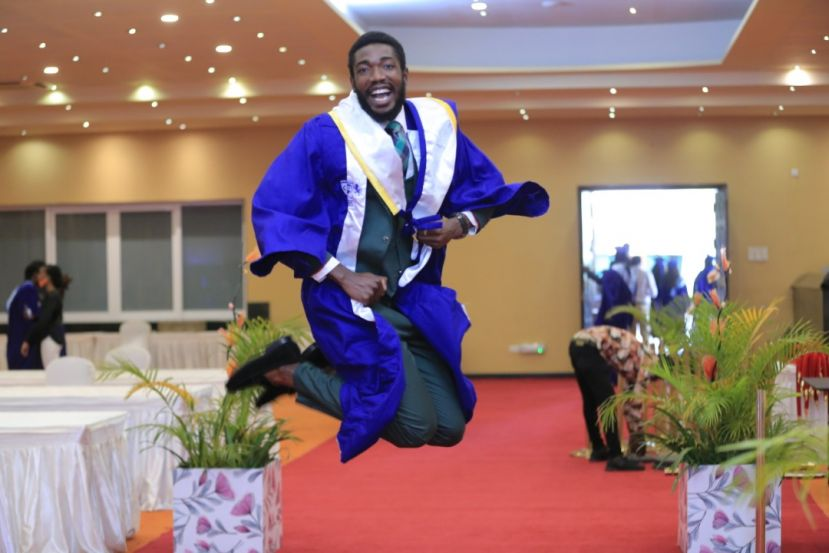 A Cavendish University student celebrates at Speke Resort Munyonyo