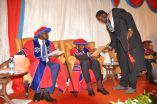 A student gets his award from Dr Martin Aliker, the chancellor of Victoria University at the second graduation ceremoney