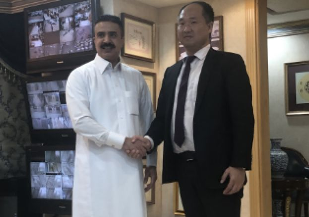 Mr. Wei Qiang and Mr. Mohammed Al-Ajlan