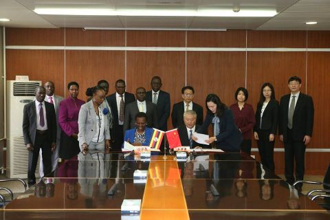 Uganda's energy minister Irene Muloni and CNNC Chairman Wang Shoujun put pen to paper in Beijing