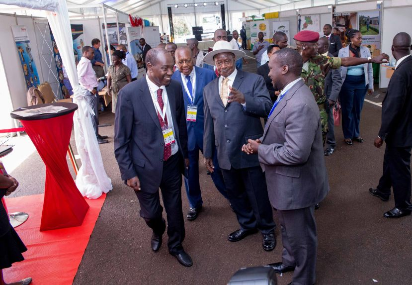 UCMP Chairman Dr Elly Karuhanga (L) and Hon Richard Kaijuka (C), the head of the UCMP's board of trustees, chats with President Museveni at a previous event
