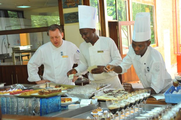 Vinz Karlsen (Extreme Left) the new Executive Chef of Sheraton Kampala Hotel on duty with his team