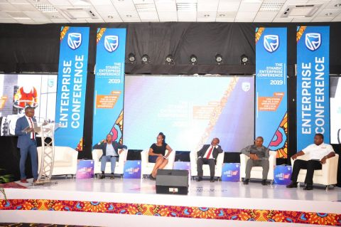 Panelists discussing opportunities in the oil and gas sector