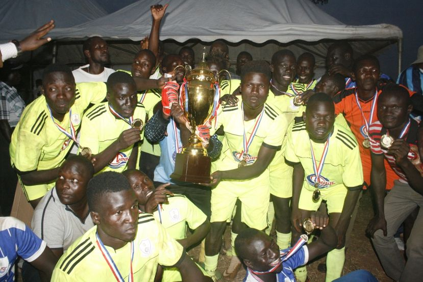 Buliisa team jubilating after receiving the trophy and a bull