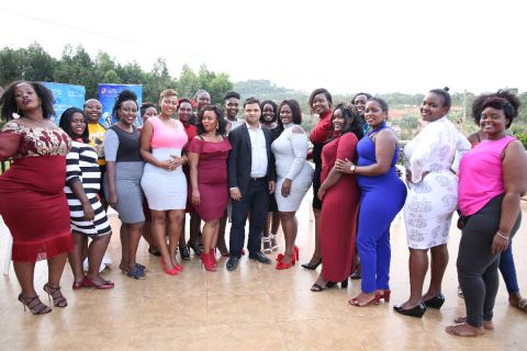 Miss Curvy contestants posing for a photo with Dr. Krishna N. Sharma, the Vice Chancellor of Victoria University