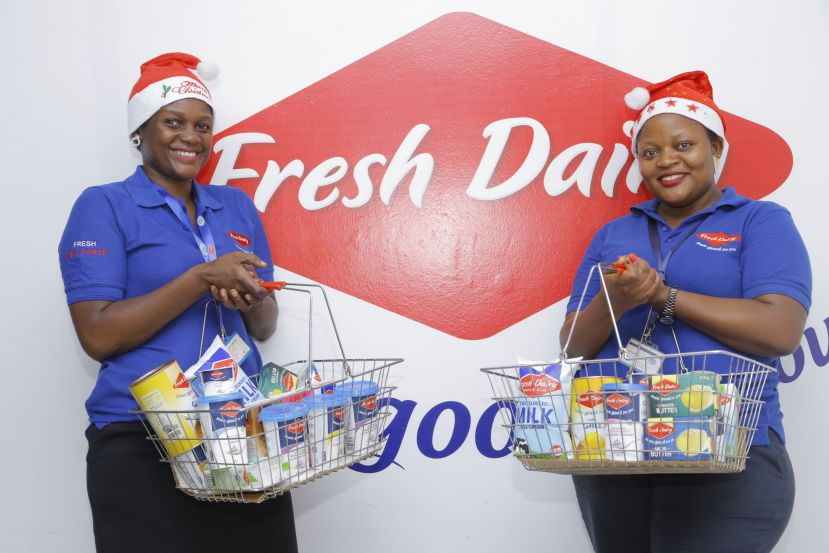 Left is Maggie Kizza Sales Manager – Fresh Dairy and Right is Monica Kulabako, Marketing Coordinator – Fresh Dairy showcasing some of the Fresh Dairy and Brookside products that can be ordered through Fresh Dairy's home delivery solution this festive season.
