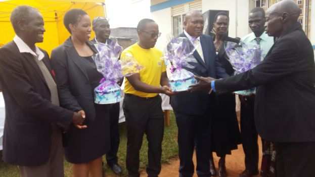 Eskom MD Ms. Thozama Gangi, MTN Foundation Manager Bryan Mbasa and South African High Commissioner Prof. Solly Mollo receive gifts from the Gulu war victims centre officials