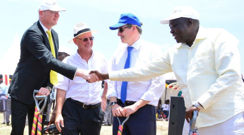 Access Power Managing Director Stephane Bontemp  (left) shakes hands with Hon. Peter Lokeris, State Minister for Mineral development after the Solar Power plant groundbreaking ceremony in Soroti on 17th March, 2016.