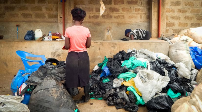 A woman sort polyethylene bags waste for recycling