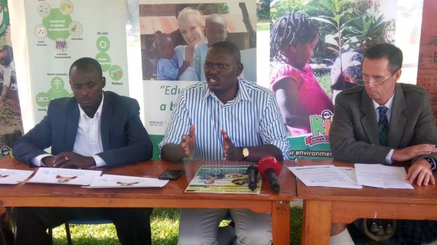 Steve Lang (R), School Director KISU, listens to Masembe at the Press Conference
