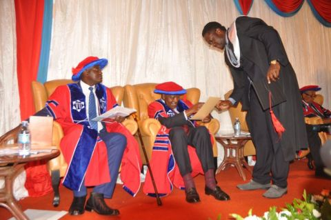 A students is awarded a degree at the second graduation ceremony of Victoria University