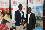 Peter Isiko (R) took over from Keith Mugabi as guild president of Victoria University