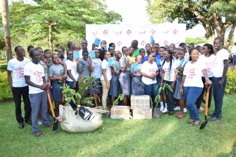 Students and staff of Bugema Adventist Secondary School share a group picture with staff from UBA
