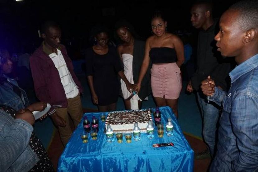 Students of Victoria University prepare to cut the freshers ball cake