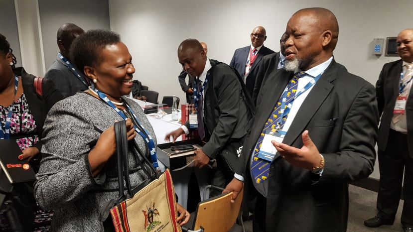 Eng Irene Muloni interacts with other diginitaries at the Africa Oil Week in Capetown