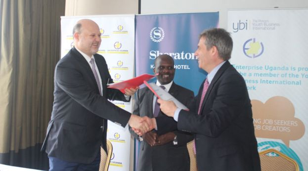 Sheraton's GM, Jean Philippe Bittencourt  (L) exchange MoU papers with Charles Ocici  the Executive Director (C) and Andrew Davenport the C.E.O (R) from Enterprise Uganda and Youth Business international respectively
