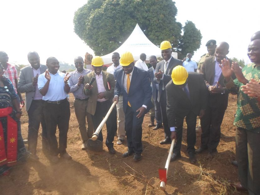State minister David Bahati, Auditor General Jonh Muwanga, and Hoima municipality MP Lawrence Bategeka launching construction of the office building