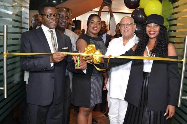 Mayiga, Sudhir and singer Sheebah cut the tape to launch the new branch of Sekanyolya Security Systems at Kingdom Kampala Mall