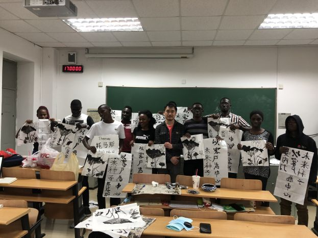 Huawei Uganda Seeds for the Future during their Chinese Calligraphy class in Beijing