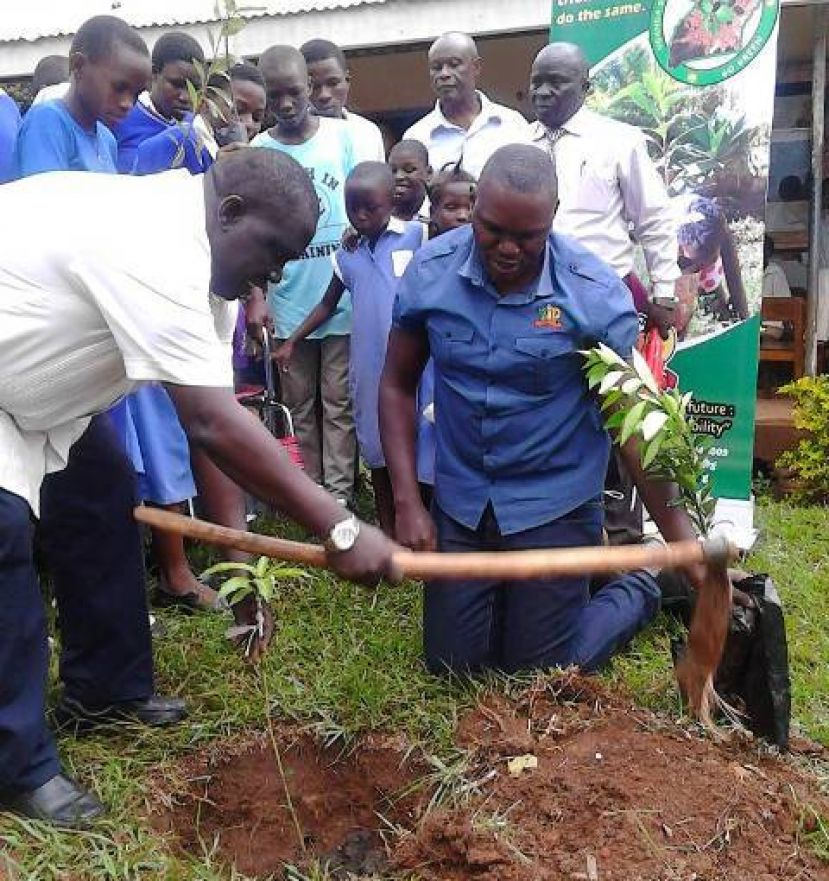 Joseph Masembe and NEMA boss Dr. Okurut plant a tree