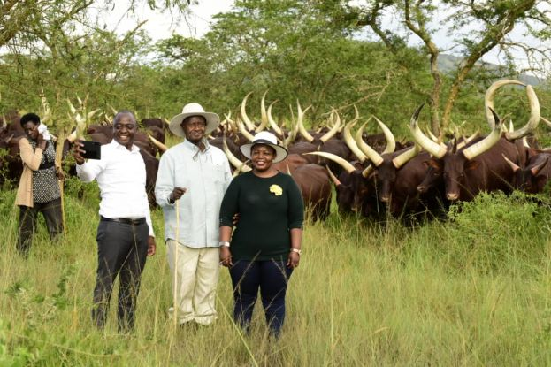 Businessman Hamis Kiggundu, President Yoweri Museveni and NRM Secretary General Justine Lumumba take pictures during a recent tour of the Presidential Ranch in Kisozi, Gomba district.