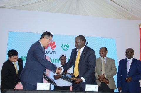 Huawei MD Liujiawei and College of Computing Principal Makerere shake hands after signing an MOU to establish ICT Academy in Uganda