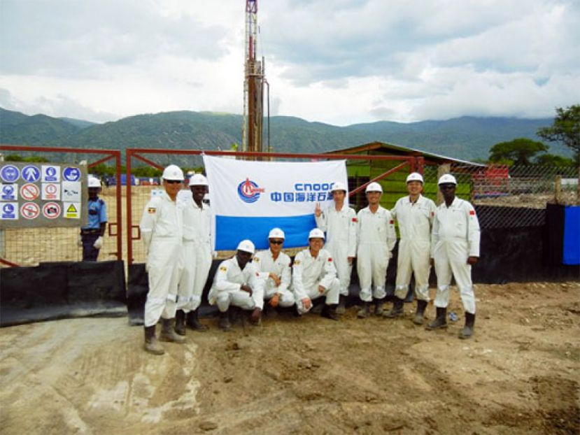 CNOOC workers pose for a photo in Western Uganda