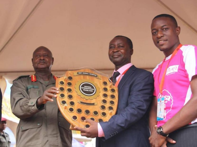 President Museveni hands over the best exhibition award to Movit team