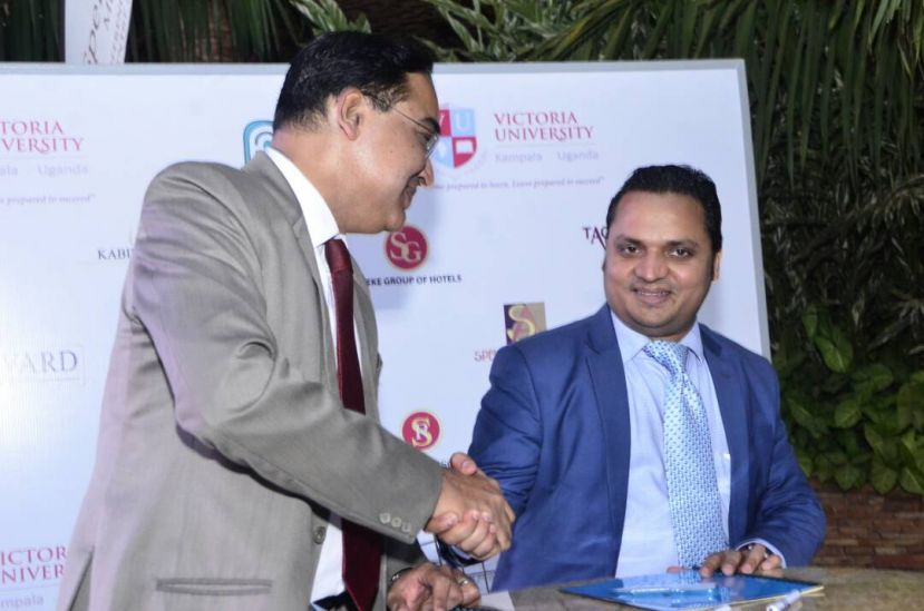 Amit Sach, Speke Group of Hotels's General Manager and Dr. Krishna N. Sharma signing the MoU