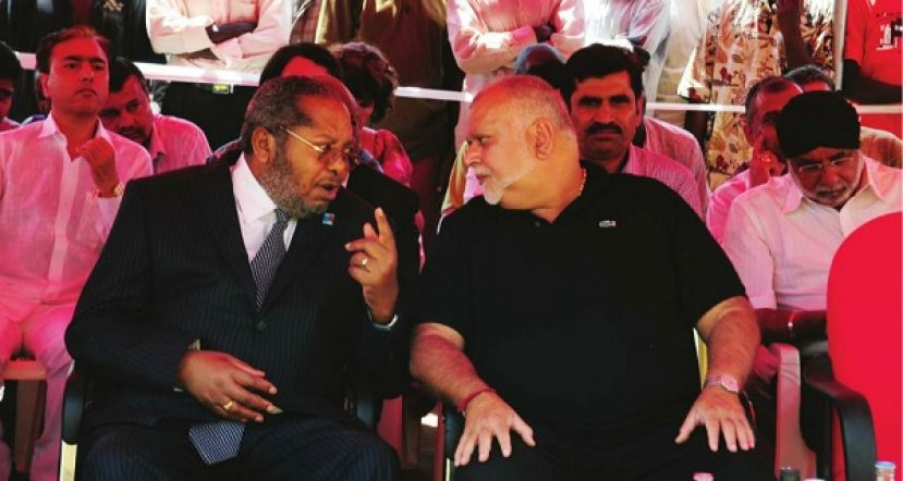 Sudhir Ruparelia and BoU governor Tumusime Mutebile