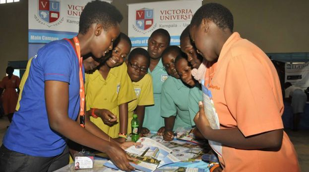 A Victoria University Staff helping students at a previous meeting