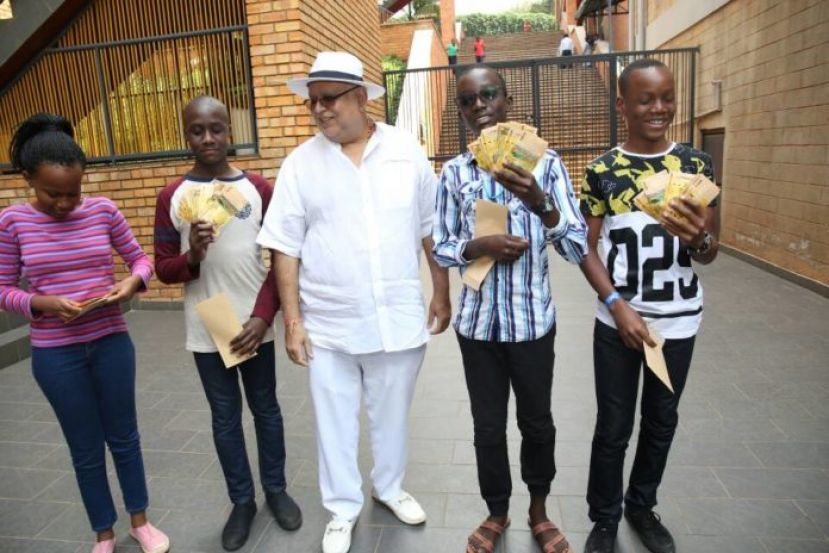 Businessman Sudhir Ruparelia rewarding top performers with cash rewards of Shs1m each